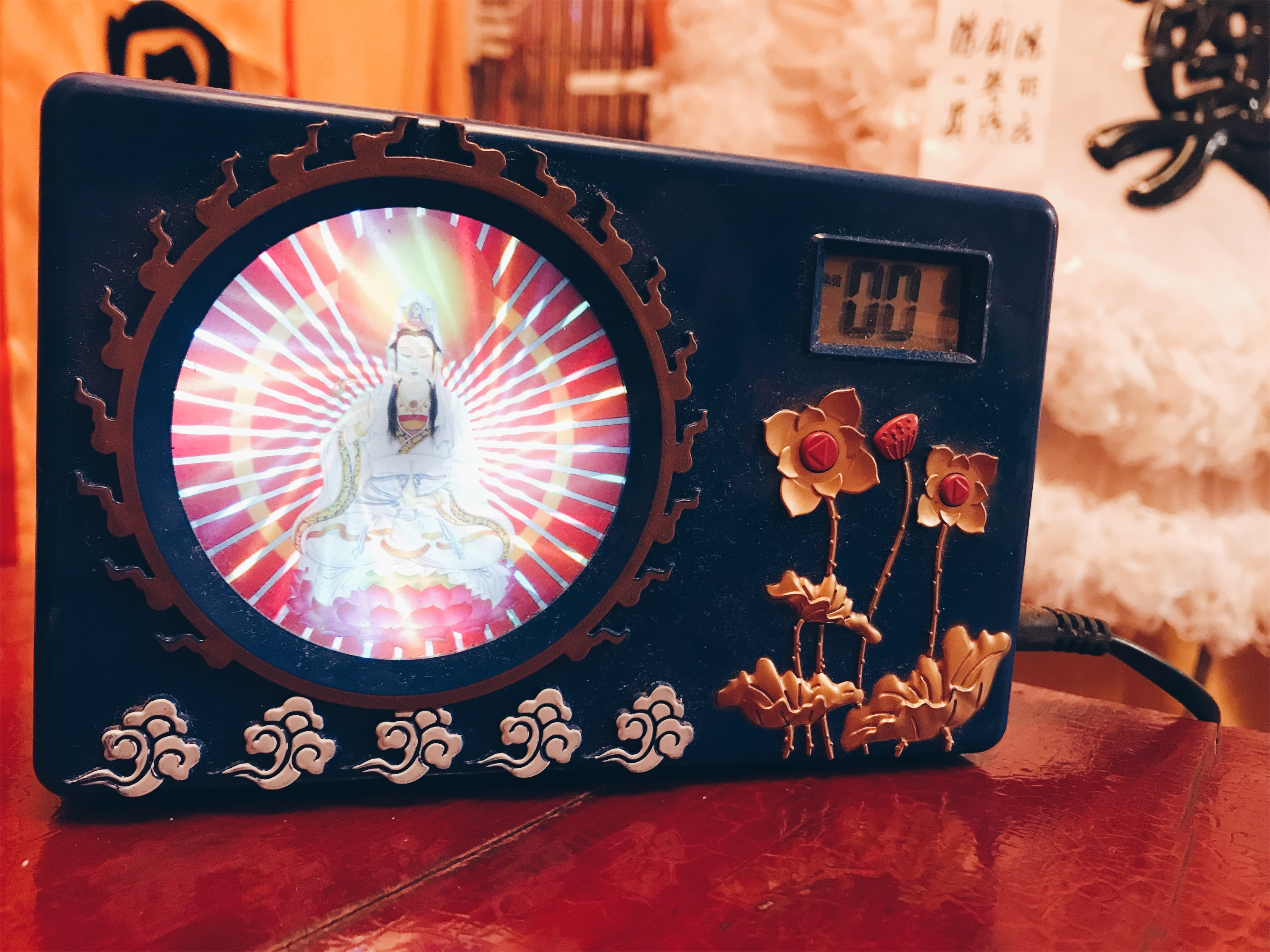 Chinese funeral - alarm clock with constant buddhist prayers