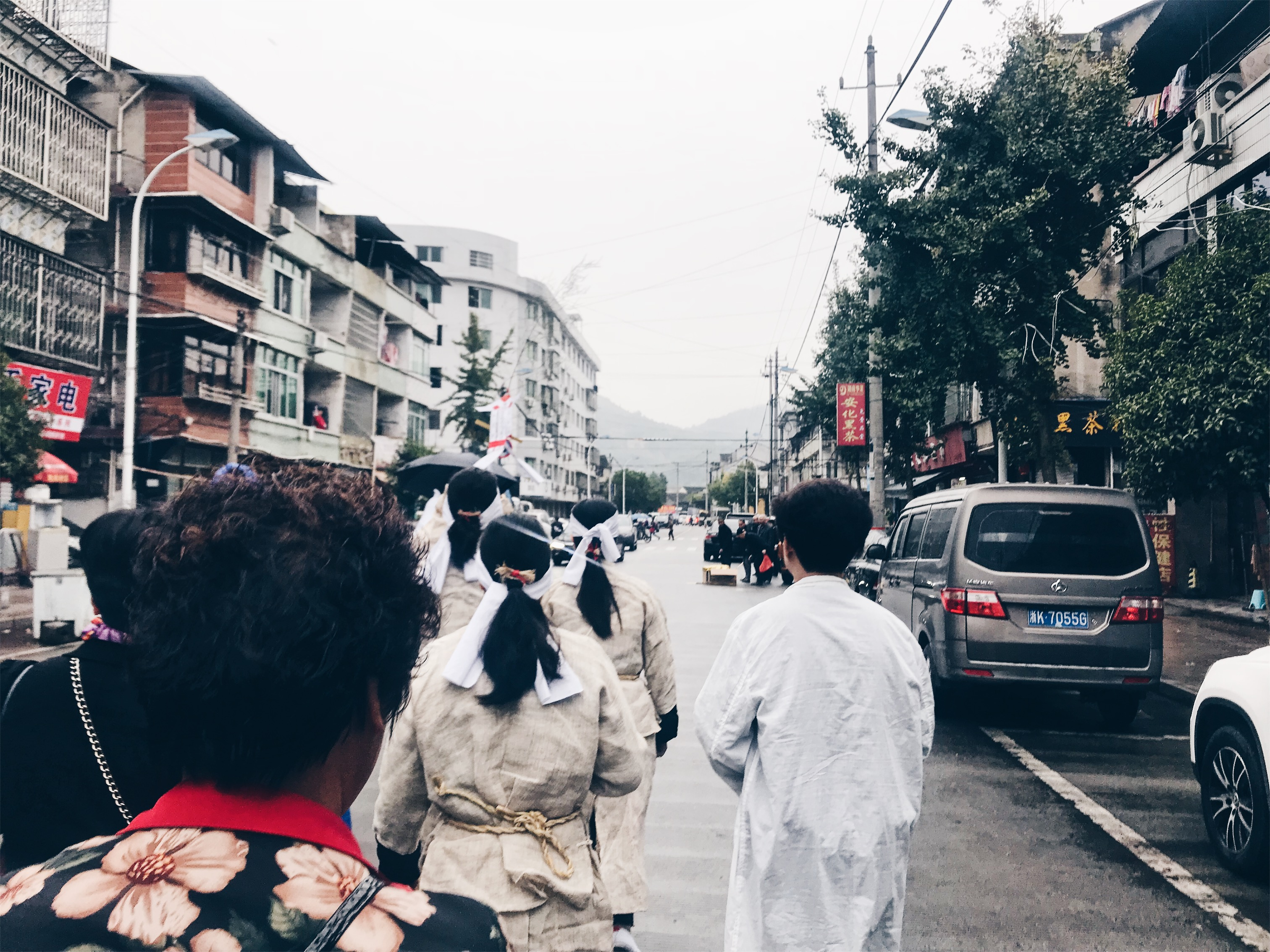 Chinese funeral - in traditional clothing through the village