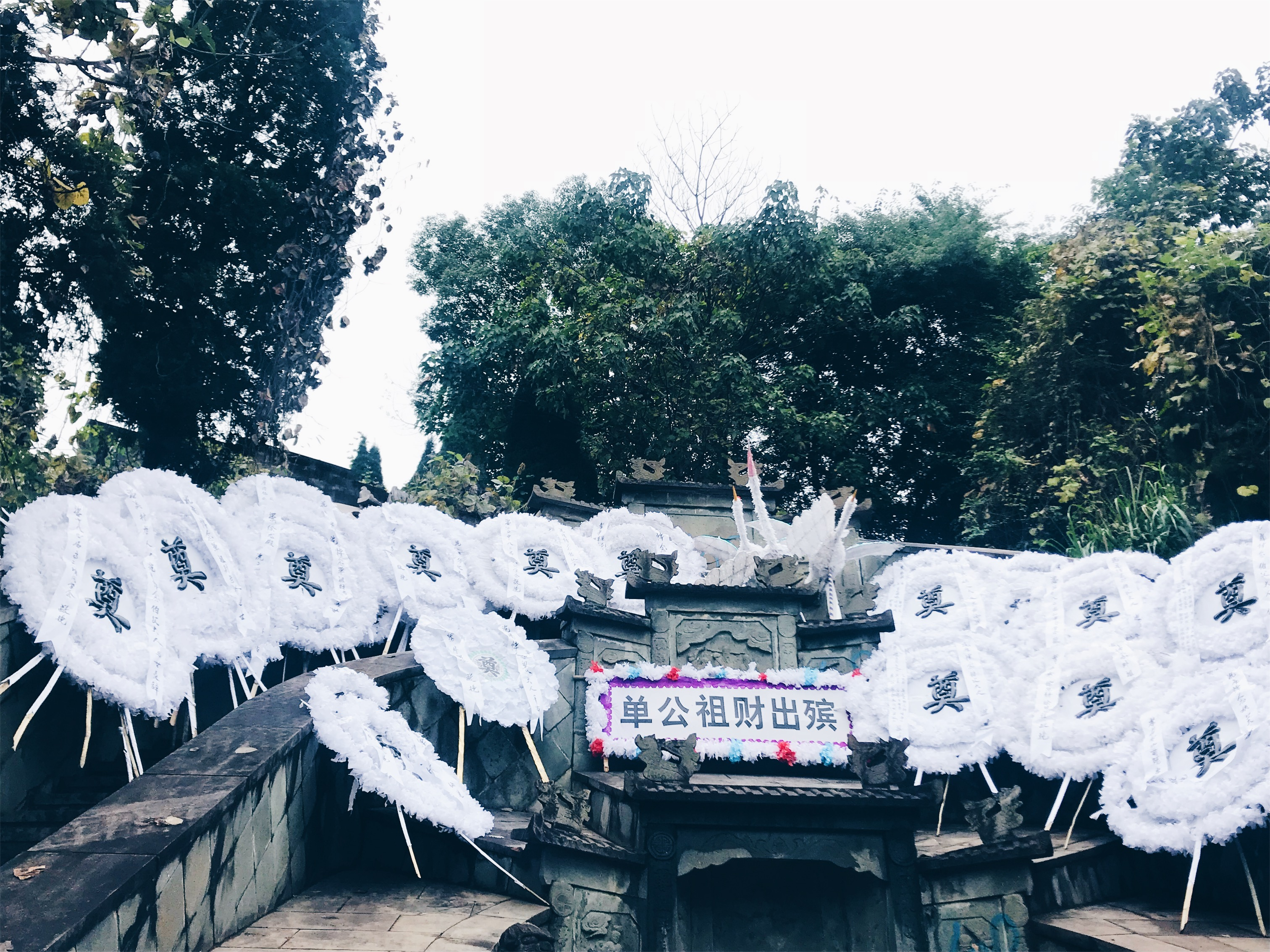 Chinese funeral - white garlands to represent the gifts